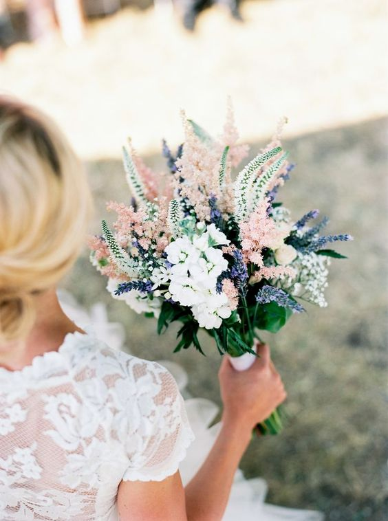 a tender pastel bouquet in white, blush and with lavender plus a very interesting shape