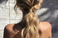 26 a wavy messy low ponytail with some locks down is great for a casual rehearsal dinner