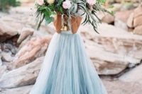 26 an oversized coastal wedding bouquet with air plants, blush and blue blooms and king proteas
