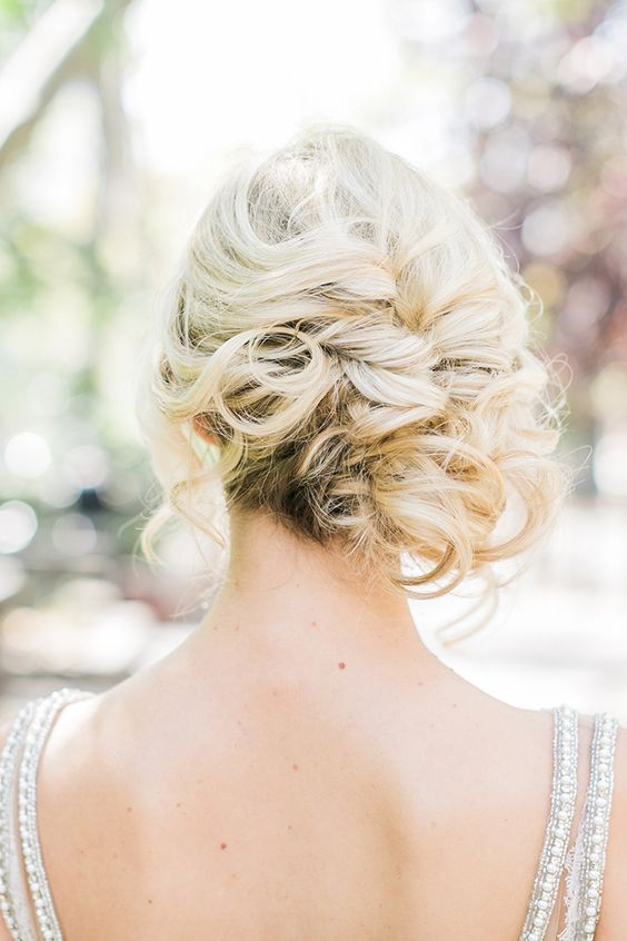 curly side updo with some locks down for a elegant feel