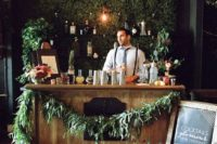 26 make a greenery wall for a wedding bar backdrop and decorate it with lights on and over it