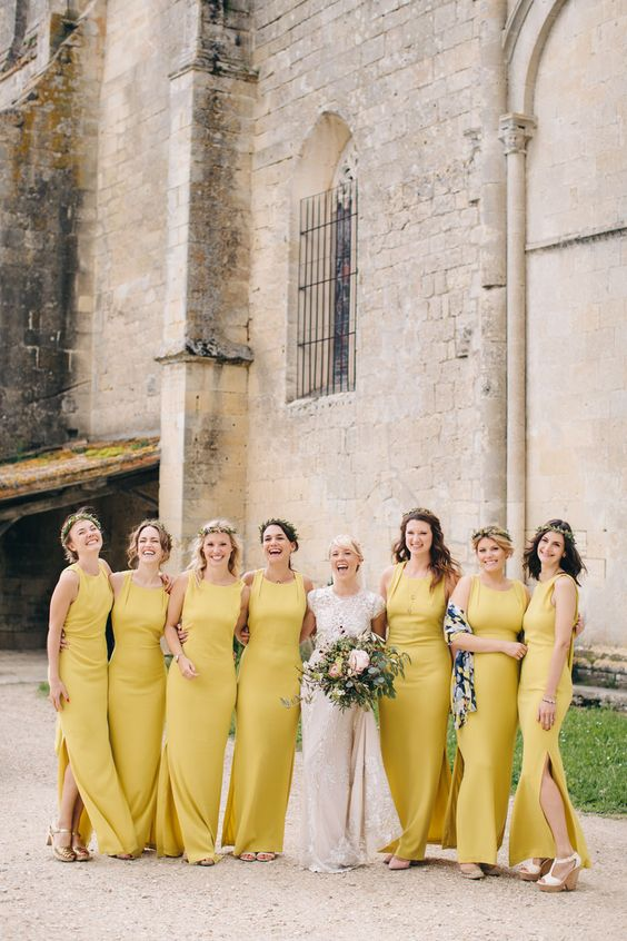 mustard yellow maxi dresses with side slits and no sleeves for a summer boho feel