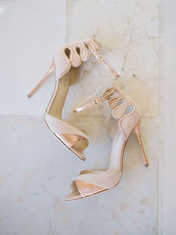 whimsy blush wedidng heels with ankle straps and glitter touches for a chic glam look