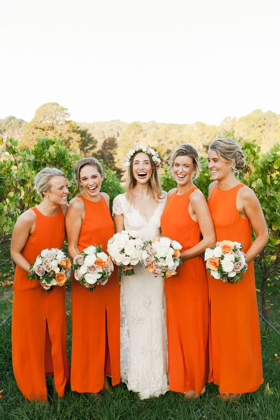 sleeveless maxi dresses with halter necklines, front slits in bold orange for a cool summer look