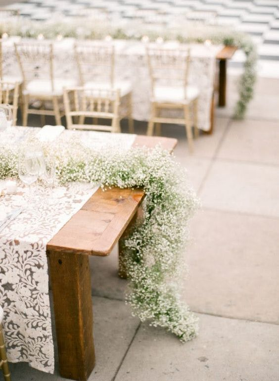 baby's breath table runners for a cozy rustic or vintage feel at the wedding