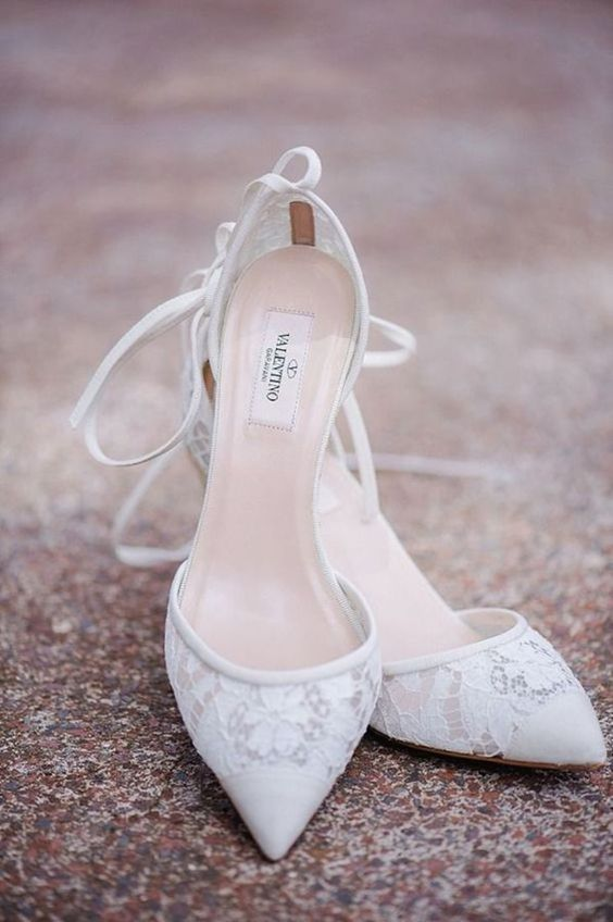 white lace pointed toe wedding heels with lacing up are a chic idea for every bridal look