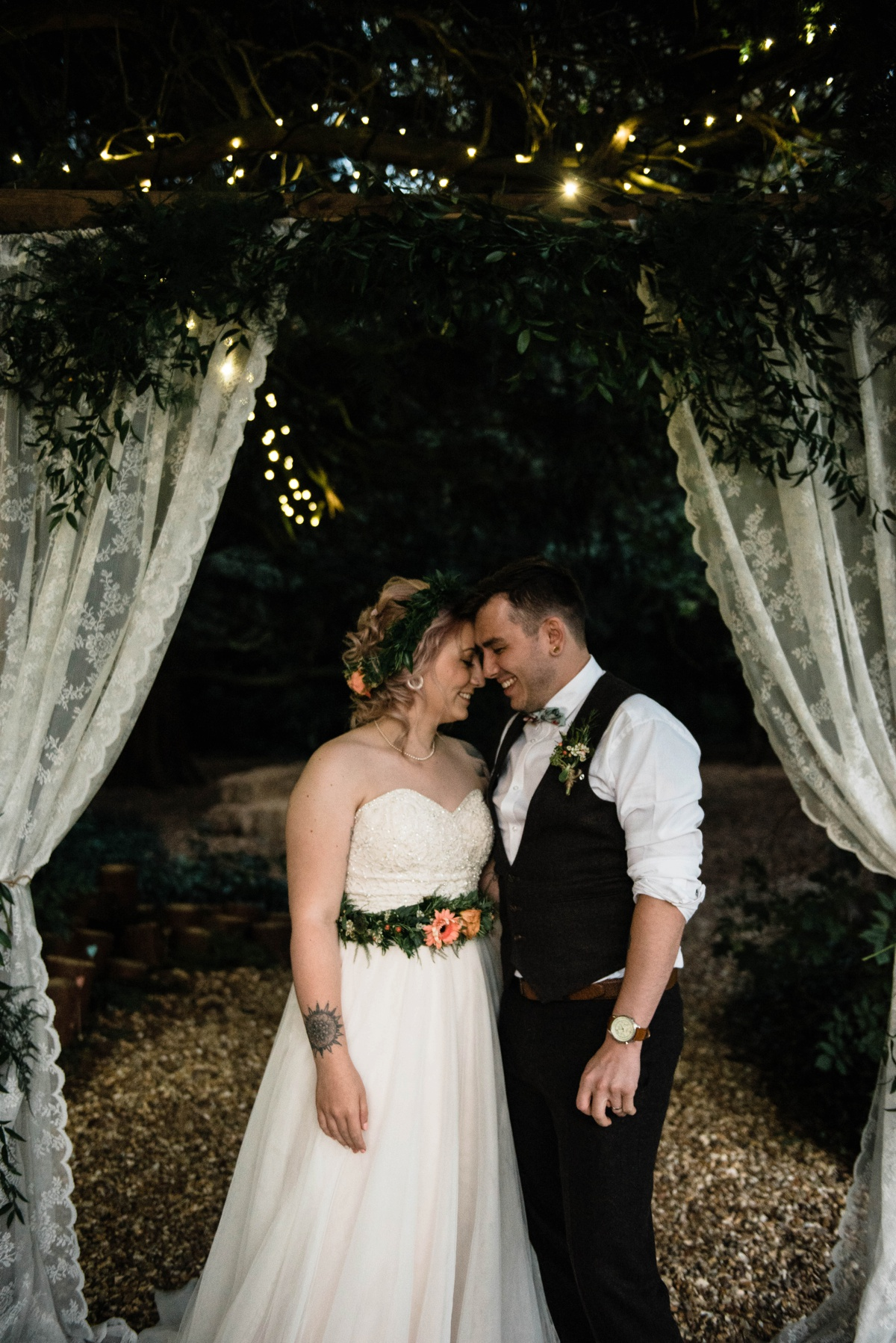 This couple wanted an outdoor rustic botanical wedding but due to the weather they had to bring everything indoors
