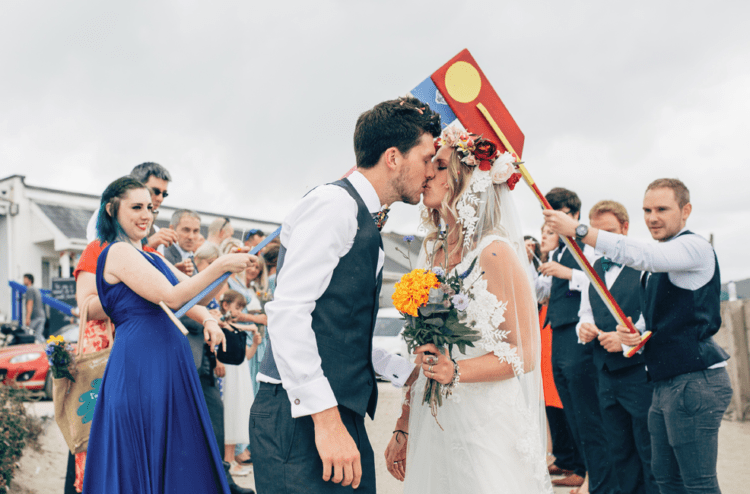 This fun and colorful geek wedding took place on the beachand was almost fully DIY