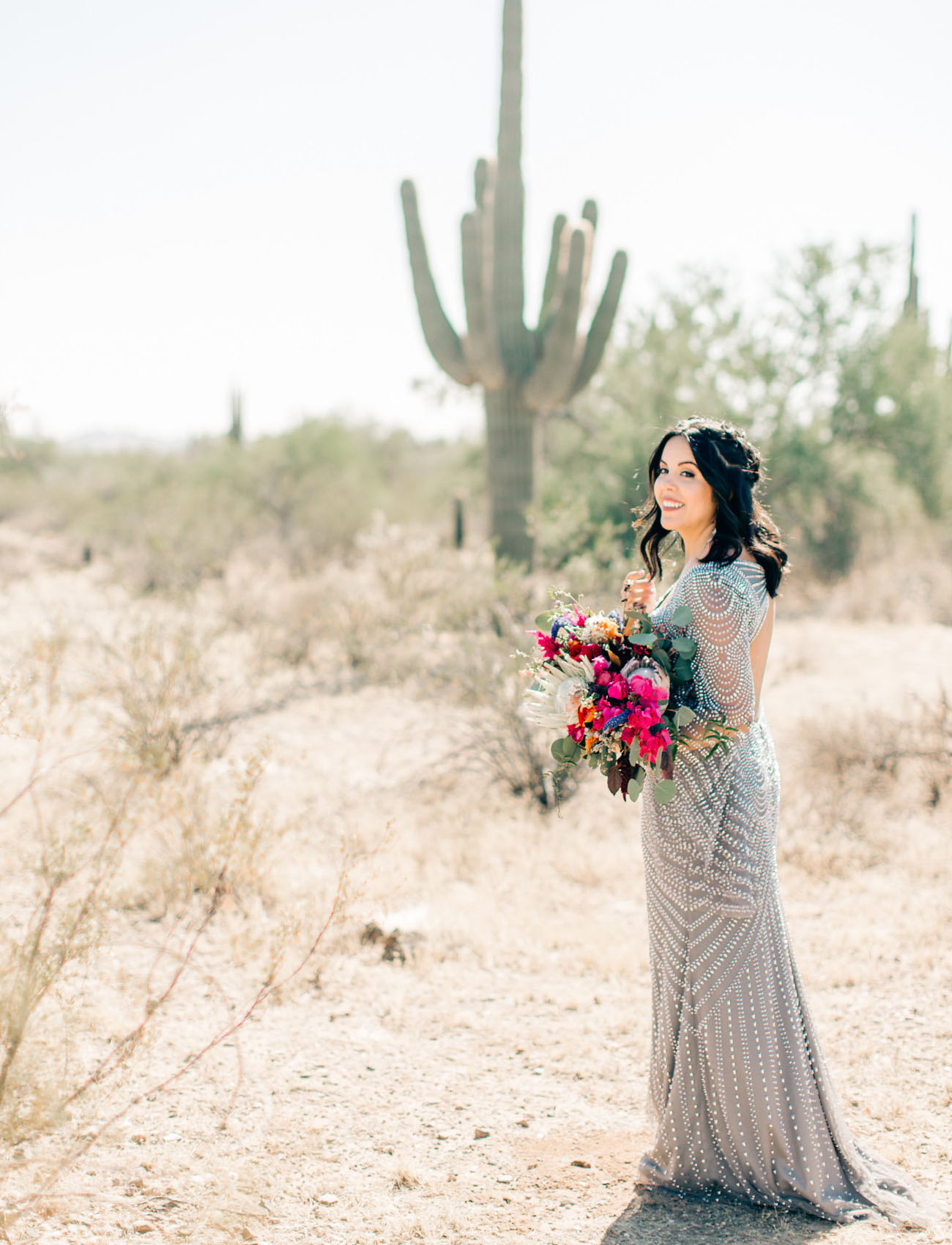 This gorgeous wedding took place right in the center of the desert and was colorful and eclectic