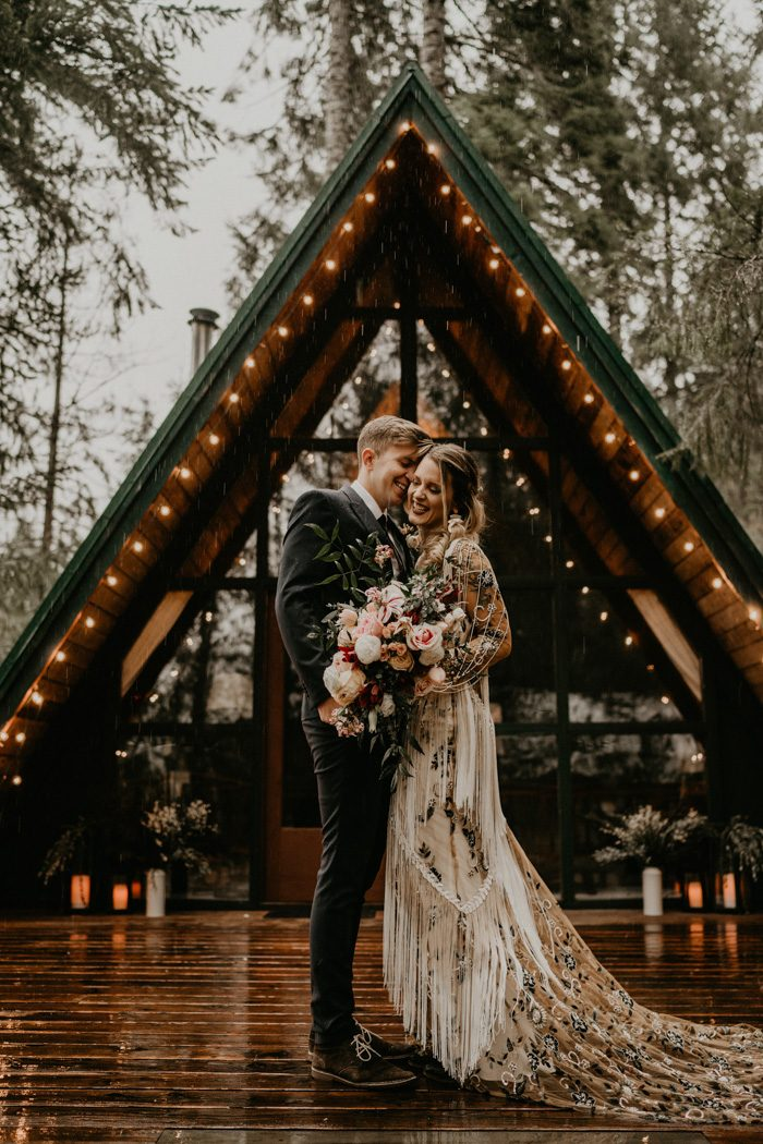 This rainy day forest elopement was a boho one, filled with moody beauty and real rain