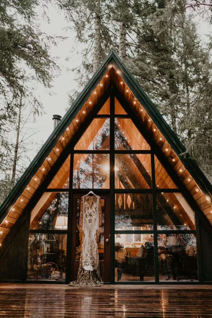 An A line forest cabin was a place to get ready and a backdrop for the ceremony