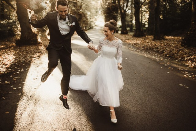 The bride was wearing her moms wedding gown with some alterations, vintage shoes and a chic top knot