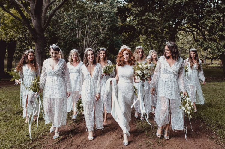 The bridesmaids were wearing silver dresses with illusion skirts and crowns