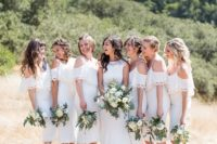 02 The bridesmaids were wearing white midi dresses with a lace trim and a cold shoulder for a cute look