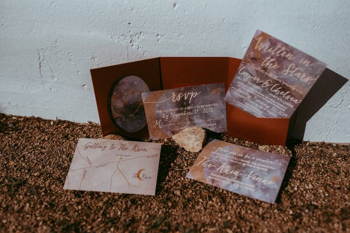 The wedding stationery was done in rust and purple colors with constellation prints, ideal for the theme