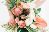02 a beautiful bouquet with blush and peachy blooms, king protea and tropical leaves