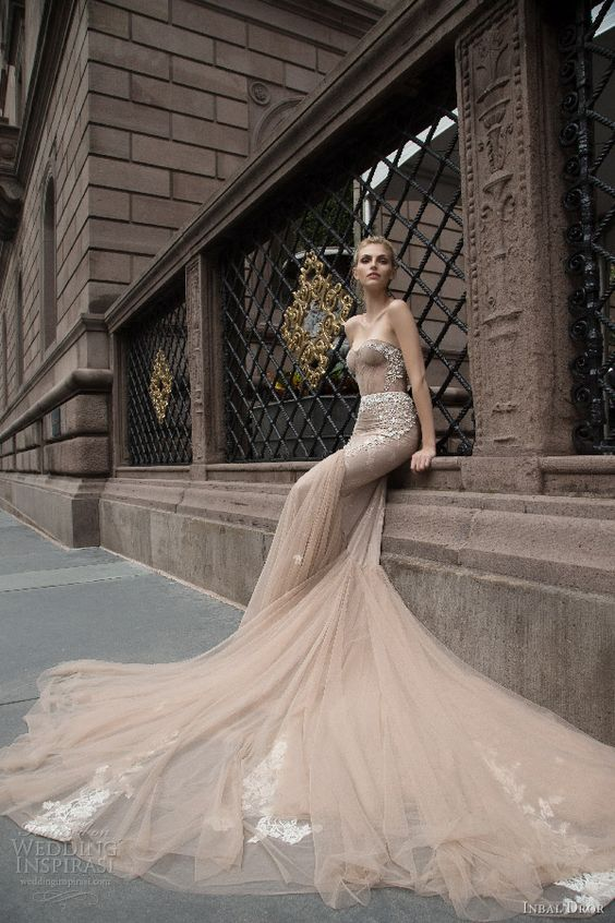 a breathtaking strapless mermaid wedding dress with rhinestones and appliques and a long train for a wow effect