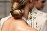 a perfect sleek knotted low bun is eye-catchy yet very simple and is ideal for a minimalist bride