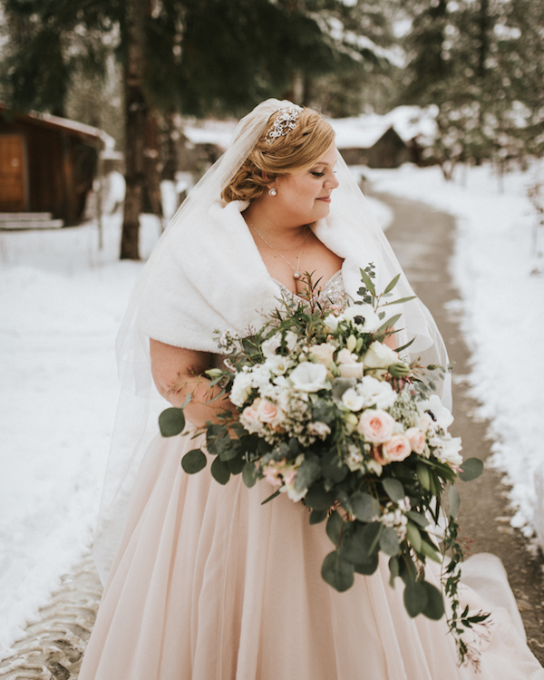 The bridal bouquet was done with textural greenery, blush and white blooms