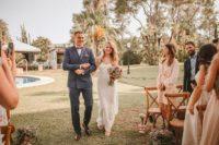 03 The bride was wearing a gorgeous white sheath spaghetti strap wedding dress with embellishments
