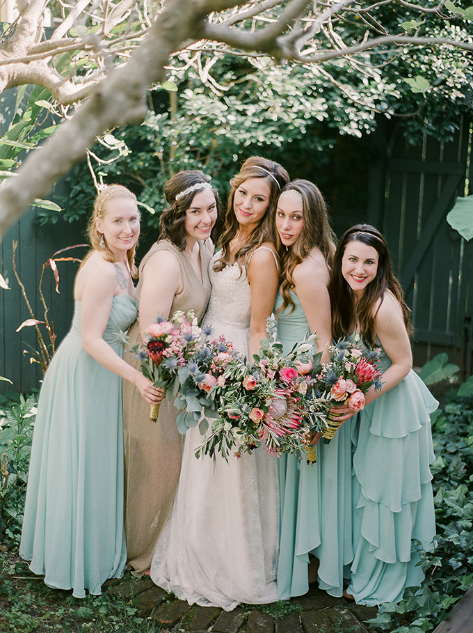 The bridesmaids were wearing dusty aqua dresses and one of them prefered a tan embellished gown