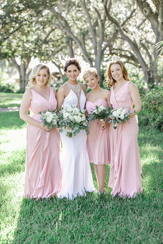 The bridesmaids were wearing same pink ruffled gowns with thick straps
