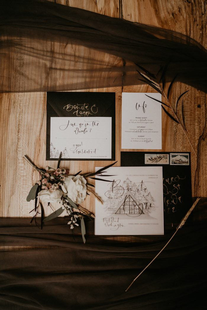 The wedding stationery was black and white, with gold calligraphy