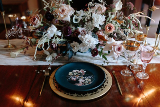 The wedding table was styled with a lush floral centerpiece with white and blush blooms