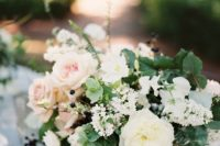 03 a fresh and lush floral centerpiece with white and blush blooms and greenery looks very cool