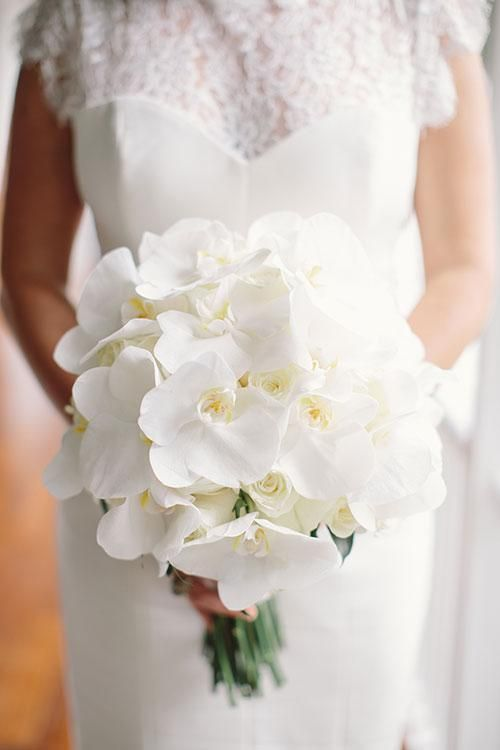 an all-white orchid wedding bouquet is timeless classics to rock