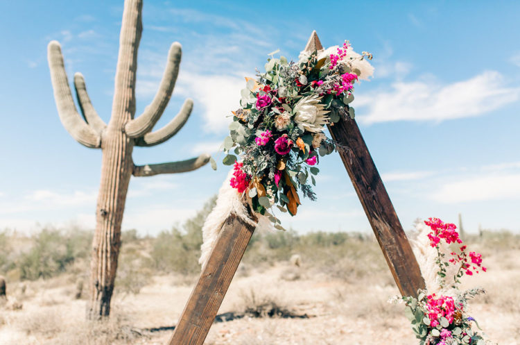 The altar was a trendy triangle one, with pampas grass and vibrant blooms