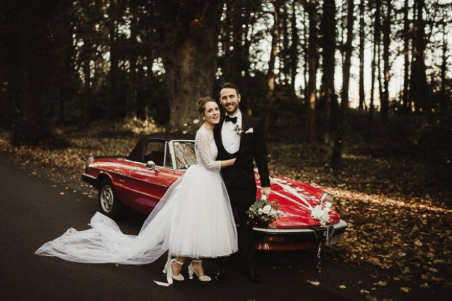 The bride gifted her groom a gorgeous vintage Alfa Romeo on the wedding day