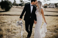 04 The first gown was a lace sheath one with an illusion neckline, the groom was rocking a black tux