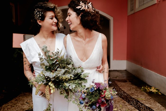 The girls were carrying different bouquets, one floral in bold colors, and the second of textural greenery