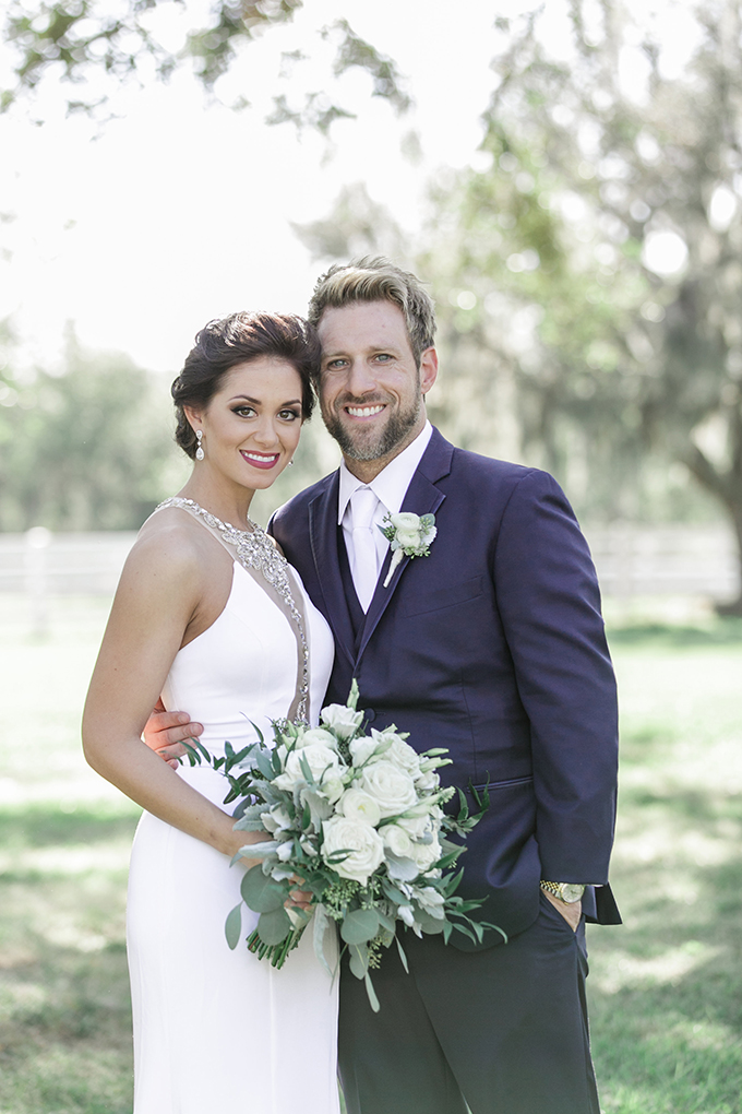 The groom was rocking a navy three-piece suit with a white shirt and tie