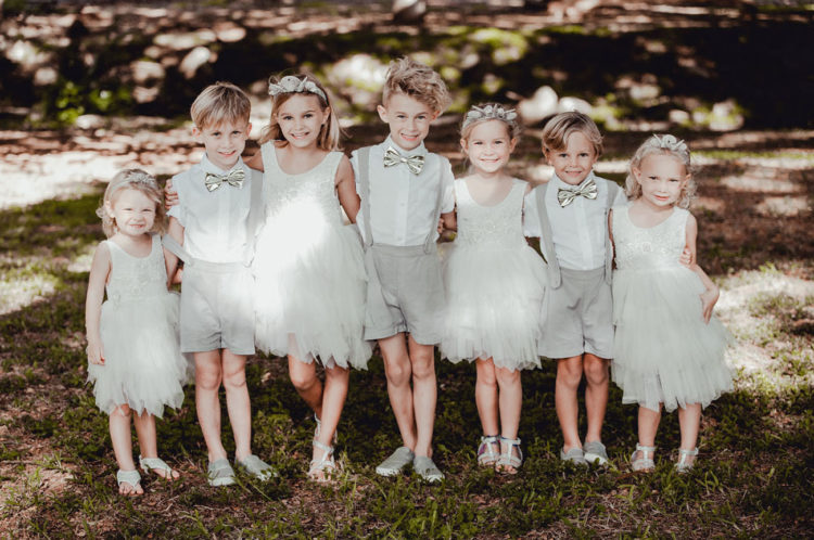 The kids were wearing dove grey and white, all the attire was sewn by the bride