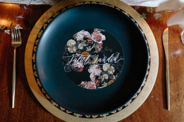 The wedding chargers were gold ones, and the plates were decorated with florals, too