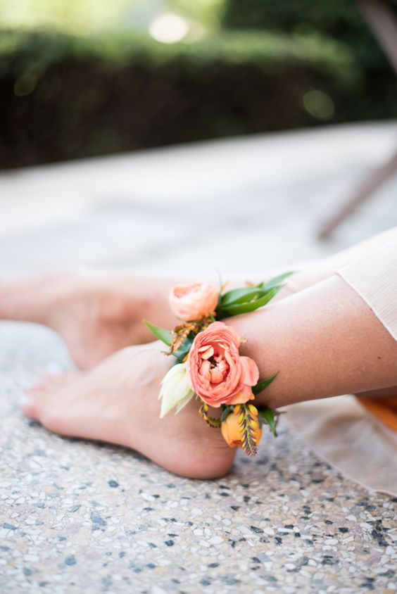 a cute floral anklet with peachy pink and yellow flowers for a delicate garden bridal look