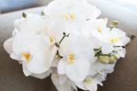 04 a glam wedding bouquet of white orchids and with a sparkling wrap is a timeless solution for every girl