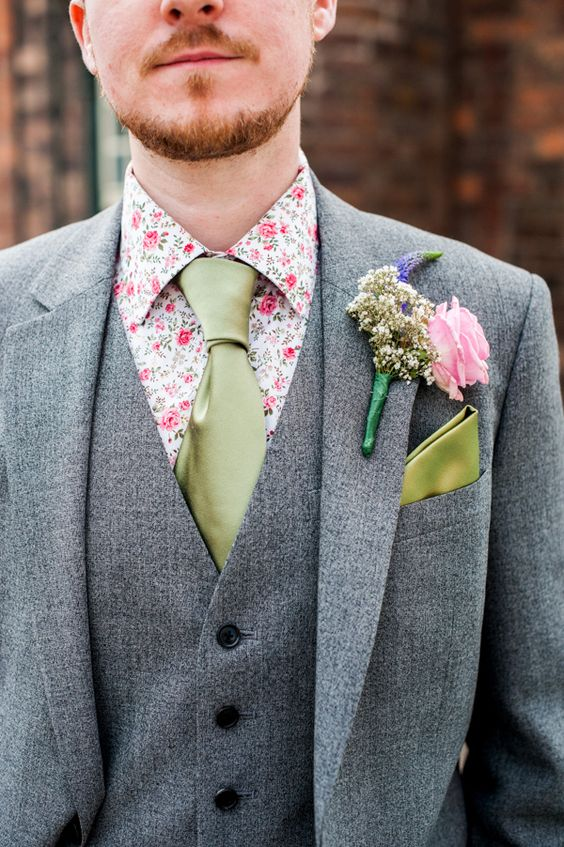 a grey three-piece suit, a green tie, a bold floral shirt for a quirky groom's look