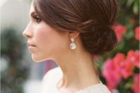 04 a low sleek sided bun is pure elegance and is suitable for a minimalist wedding