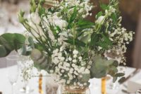 04 a refreshing greenery and floral centerpiece with lily of the valley for a rustic summer wedding