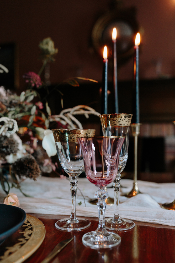 Black candles and gold rim and pink glasses added depth and color to the setting