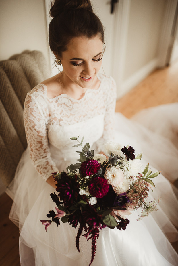 The bridal bouquet was done in plum, white and green blooms