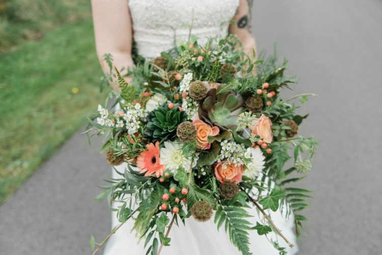 The bridal bouquet was done with succulents, ferns and peachy blooms