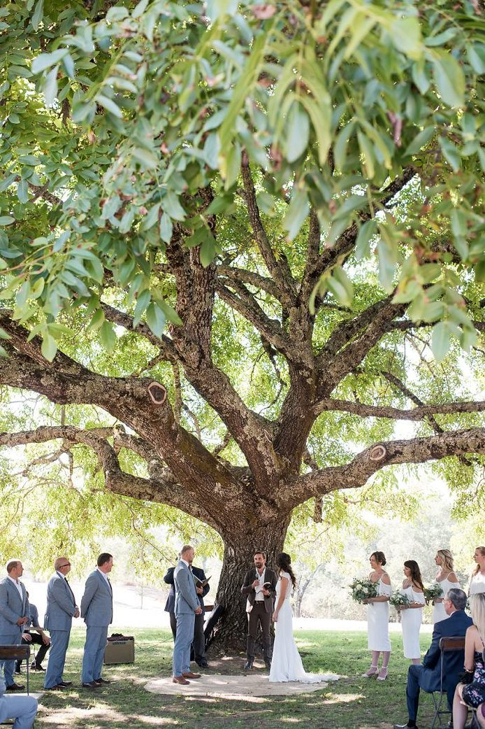 The ceremony took place under a tree for a natural look