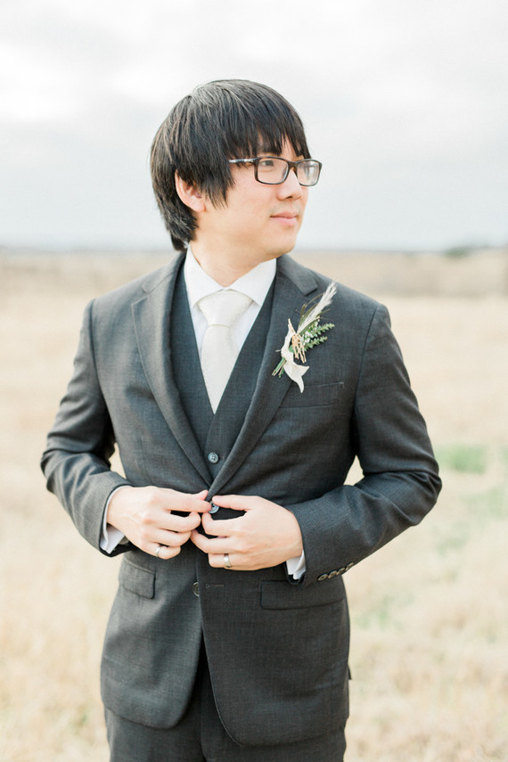 The groom was rocking a dark greey three-piece wedding suit, a white shirt and tie