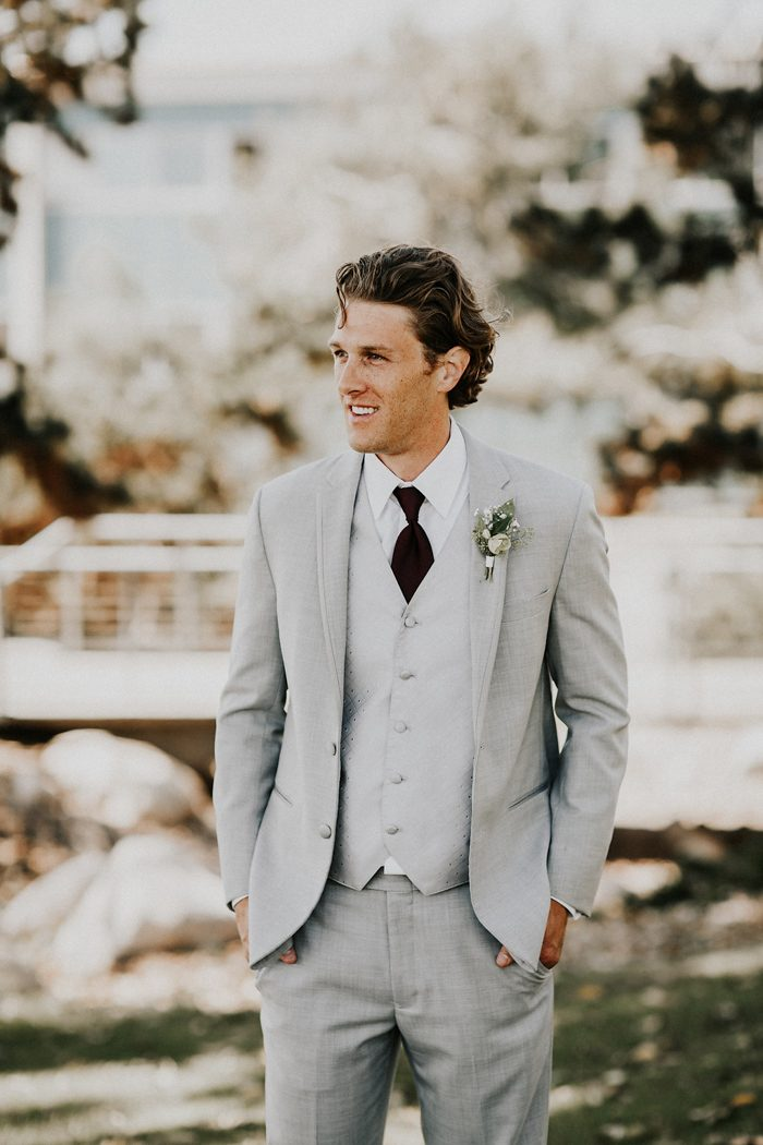 The groom was rocking a light grey three-piece wedding suit with a burgundy tie