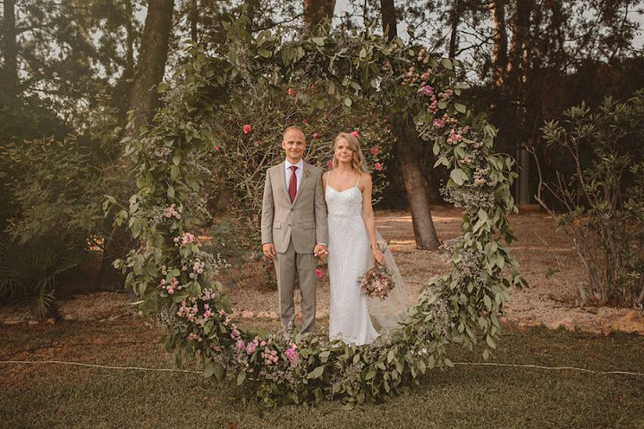 The wedding arch was a trendy oversized circle one done with lush greenery and pink blooms