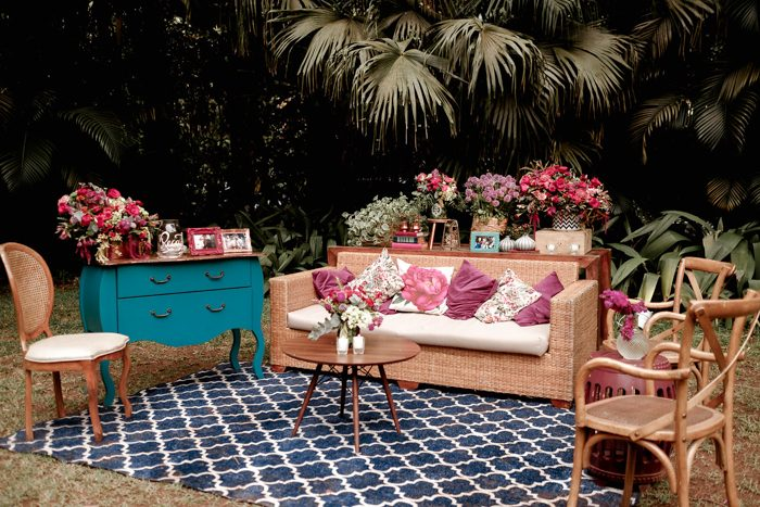 The wedding lounge was done with rattan furniture and lots of bold blooms